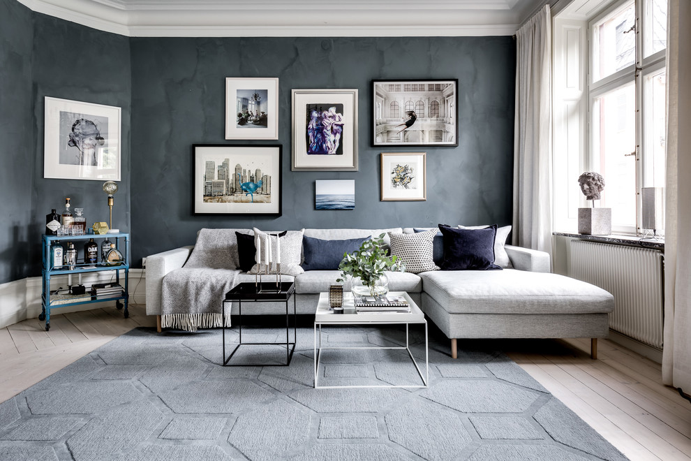 Living room - large scandinavian formal and open concept light wood floor and white floor living room idea in Stockholm with black walls