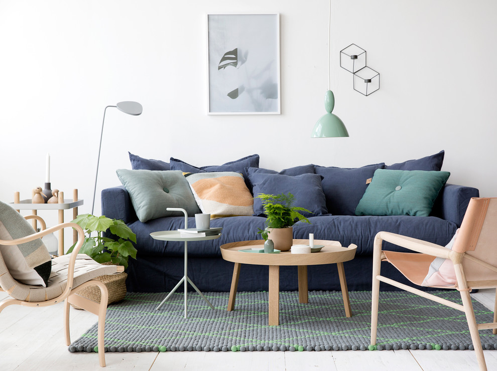 Inspiration for a scandinavian formal and open concept painted wood floor living room remodel in Gothenburg with white walls, no fireplace and no tv