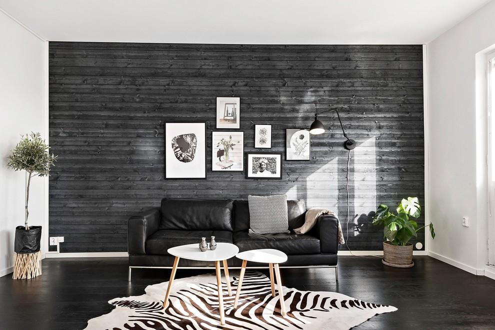 Inspiration for a large scandinavian open concept black floor and dark wood floor living room remodel in Stockholm with black walls