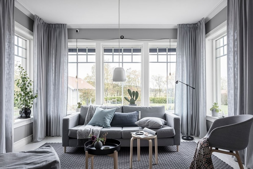 Inspiration for a scandinavian painted wood floor living room remodel in Other with gray walls and no fireplace