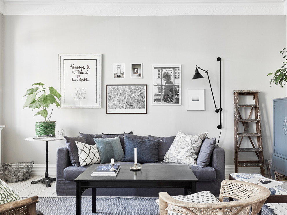 Inspiration for a mid-sized modern formal and open concept painted wood floor living room remodel in Gothenburg with gray walls and no tv