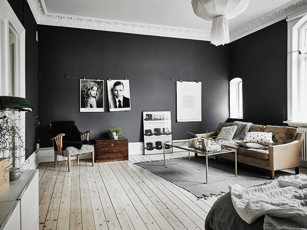 Living room - mid-sized scandinavian formal and enclosed light wood floor living room idea in Gothenburg with black walls and no fireplace