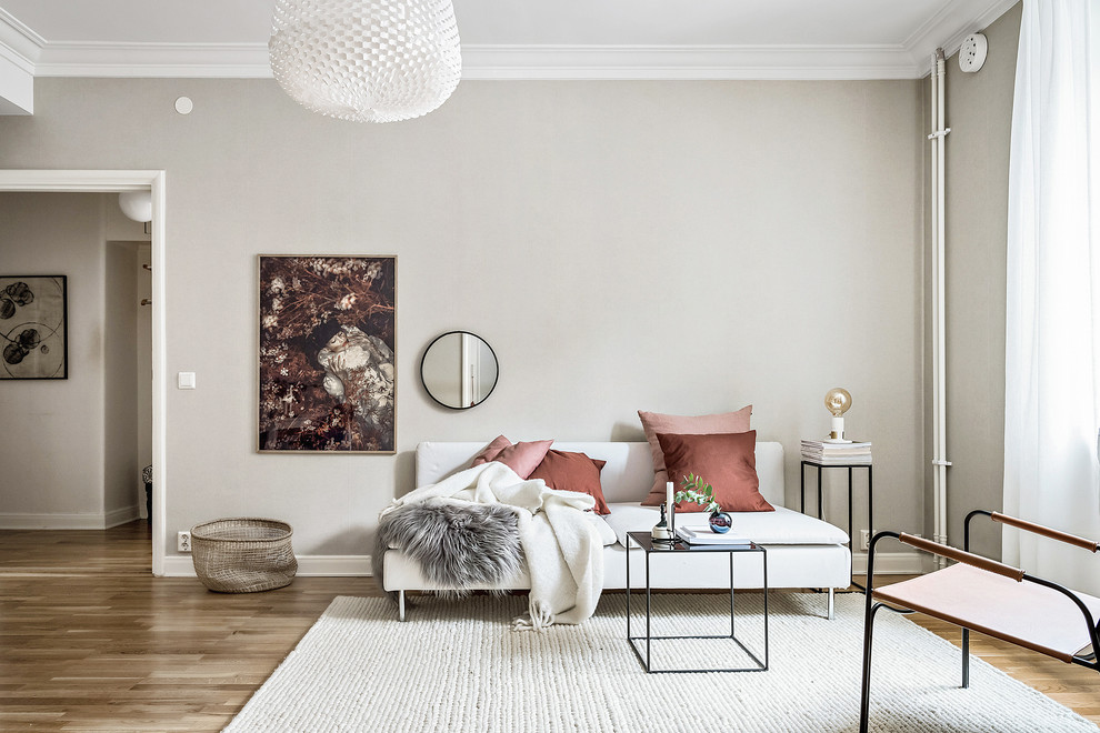 Mid-sized danish formal and enclosed medium tone wood floor and brown floor living room photo in Gothenburg with gray walls and no fireplace
