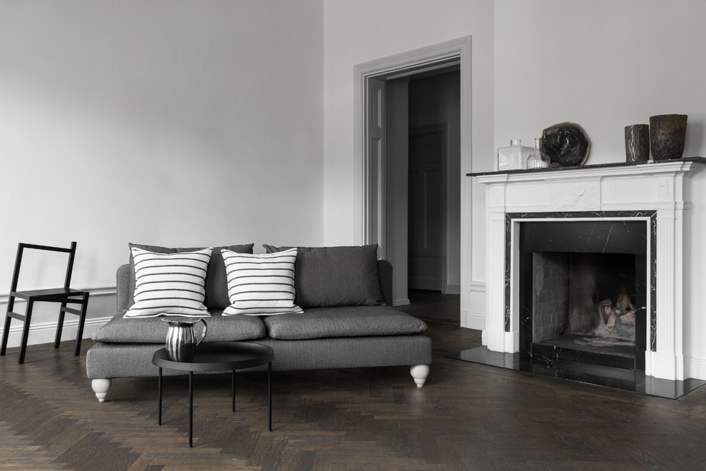 Inspiration for a large scandinavian dark wood floor and brown floor living room remodel in Other with gray walls, a wood stove and a stone fireplace