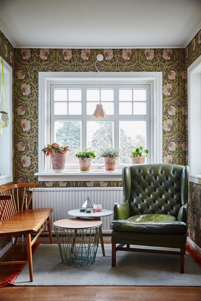Living room - mid-sized traditional formal and enclosed dark wood floor living room idea in Gothenburg with multicolored walls