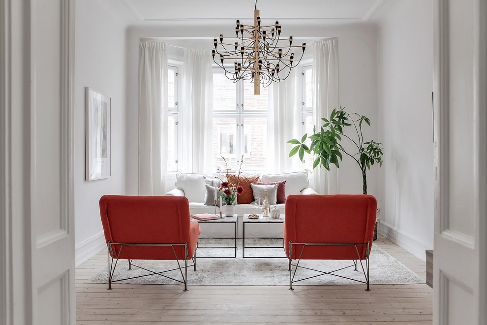 Inspiration for a mid-sized scandinavian formal and enclosed light wood floor and beige floor living room remodel in Malmo with white walls, no fireplace and no tv