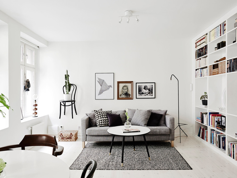 Living room - large scandinavian formal and open concept light wood floor living room idea in Gothenburg with white walls, no tv and no fireplace