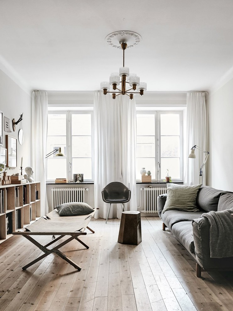 Living room - mid-sized scandinavian formal and enclosed light wood floor and beige floor living room idea in Malmo with white walls and no tv