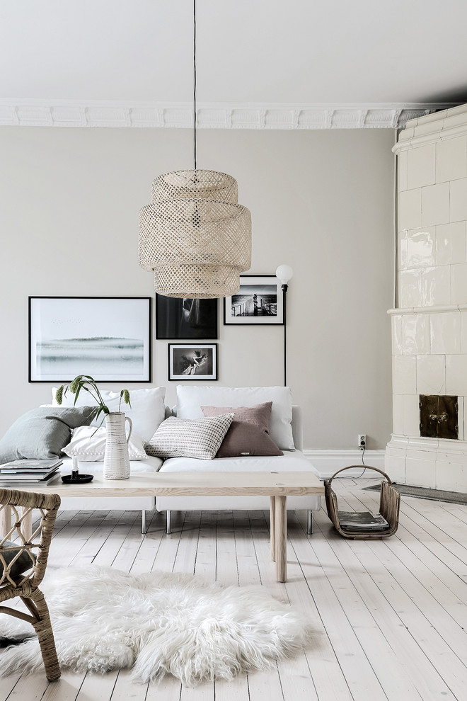 Example of a large ornate light wood floor living room design in Gothenburg with beige walls
