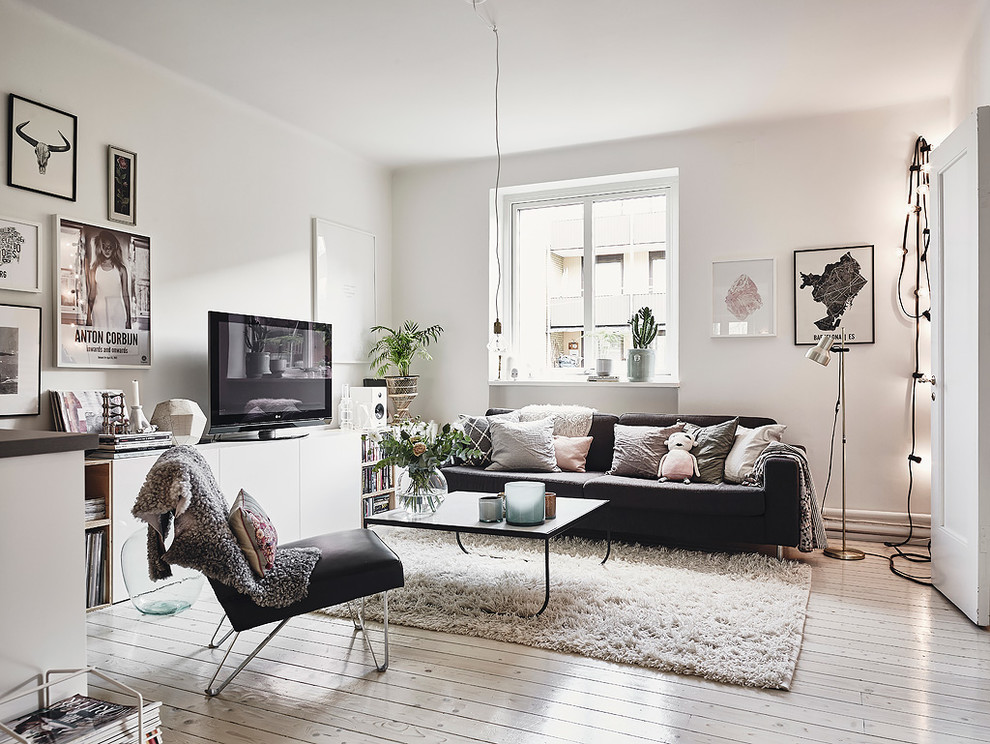 Mid-sized danish open concept painted wood floor living room photo in Gothenburg with white walls, no fireplace and a tv stand
