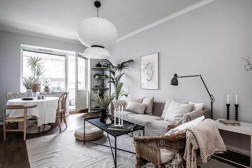 Danish dark wood floor and brown floor living room photo in Stockholm with gray walls