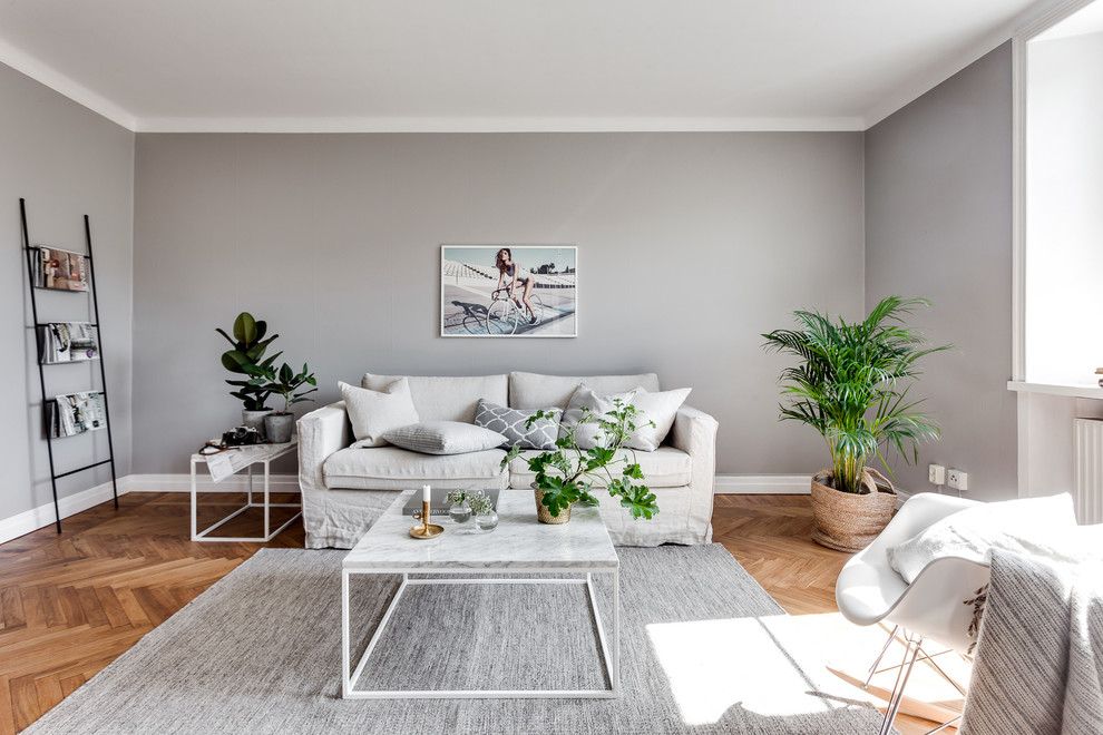 Inspiration for a mid-sized scandinavian formal and open concept light wood floor living room remodel in Stockholm with gray walls, no fireplace and no tv