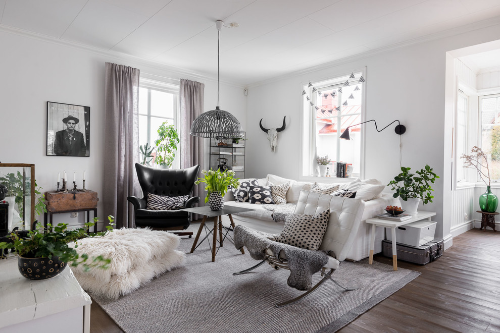 Example of a mid-sized danish open concept and formal dark wood floor living room design in Gothenburg with white walls and no fireplace