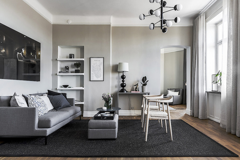 Living room - mid-sized scandinavian formal medium tone wood floor and brown floor living room idea in Stockholm with gray walls, no fireplace and no tv