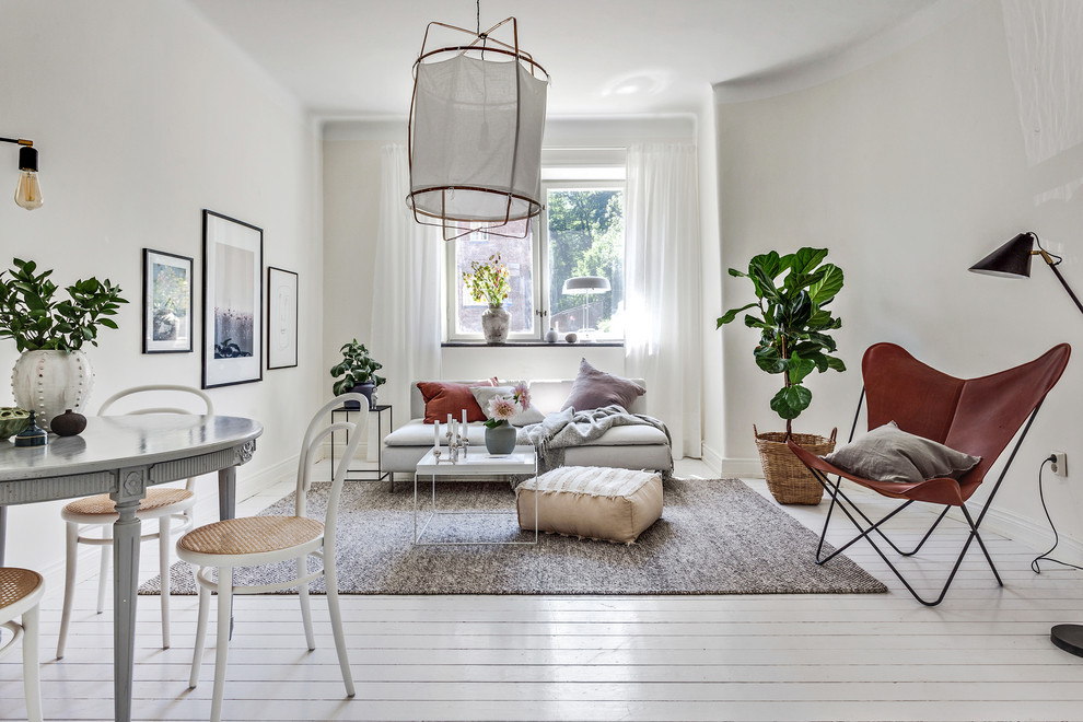 Living room - mid-sized scandinavian open concept painted wood floor and white floor living room idea in Gothenburg with white walls and no fireplace