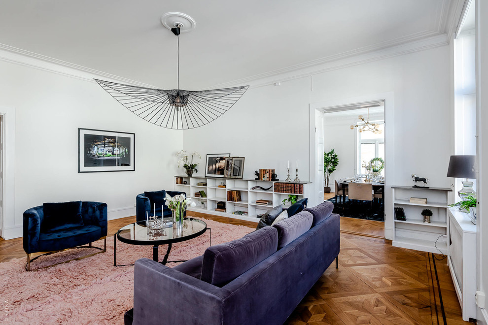 Mid-sized danish enclosed medium tone wood floor and brown floor living room photo in Stockholm with white walls, no fireplace and no tv