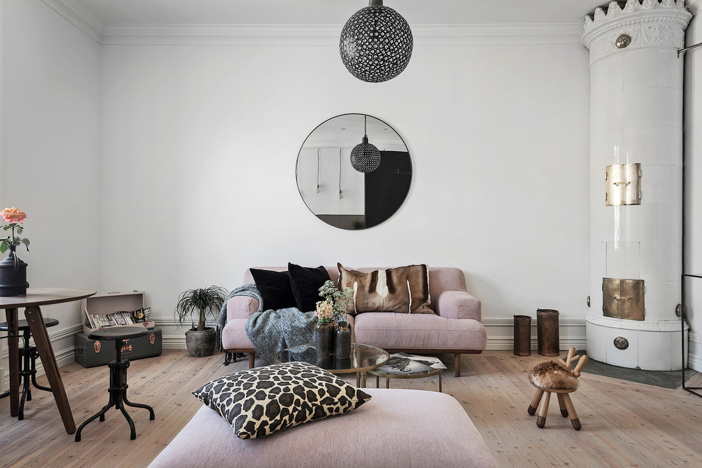 Inspiration for a mid-sized scandinavian formal and open concept light wood floor living room remodel in Stockholm with white walls, a corner fireplace and no tv