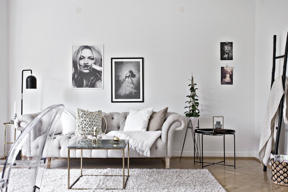 Inspiration for a mid-sized scandinavian formal and open concept light wood floor living room remodel in Gothenburg with white walls and no tv