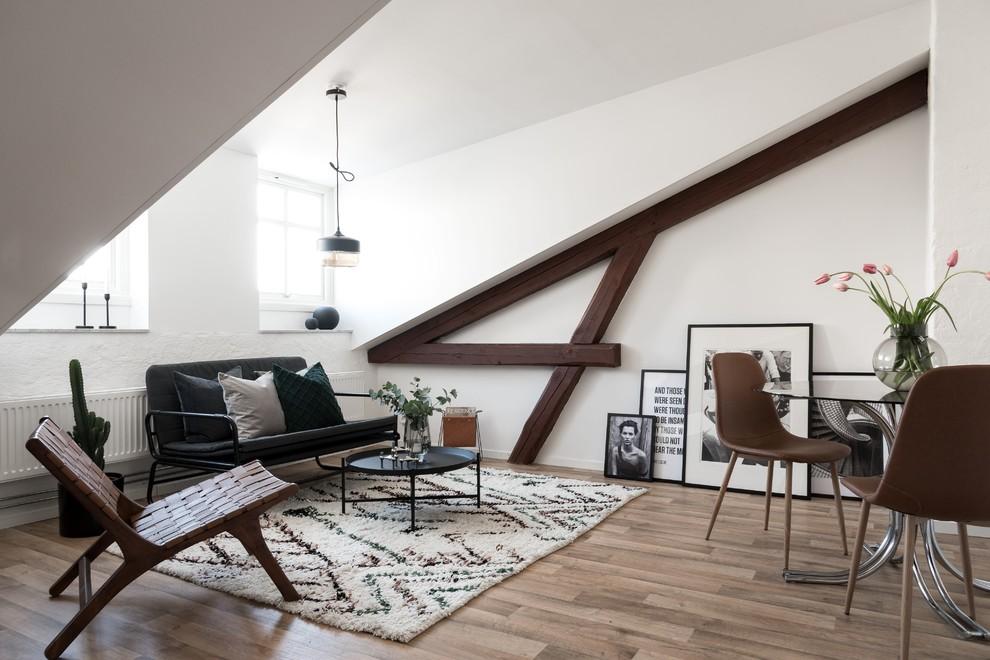 Living room - scandinavian open concept light wood floor and brown floor living room idea in Other with white walls