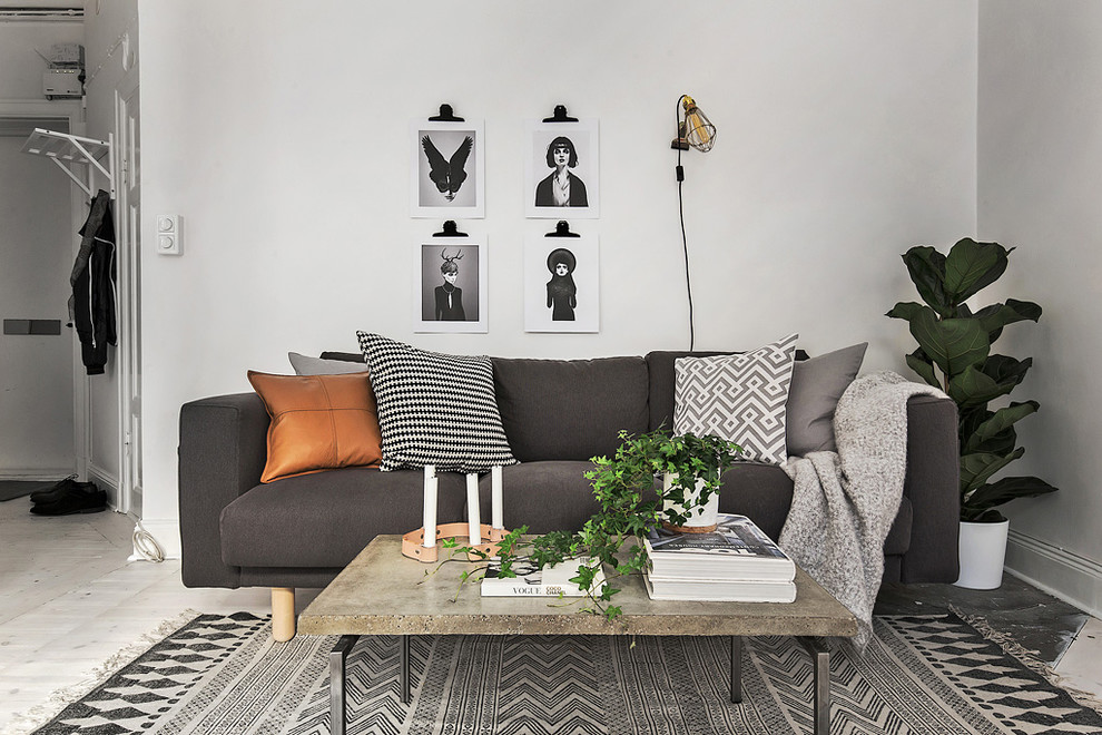 Inspiration for a mid-sized scandinavian open concept and formal painted wood floor living room remodel in Stockholm with white walls, no fireplace and no tv