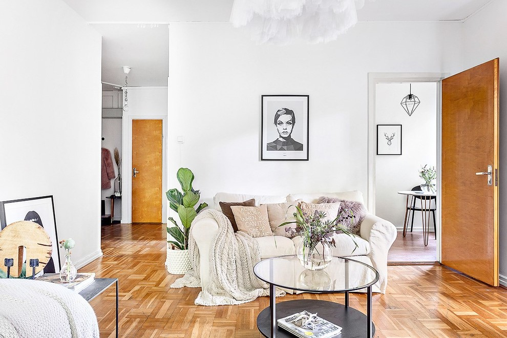Example of a mid-sized danish open concept and formal light wood floor living room design in Stockholm with white walls, no fireplace and no tv