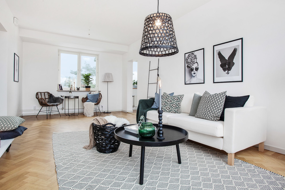 Large danish enclosed and formal light wood floor living room photo in Stockholm with white walls, no fireplace and no tv