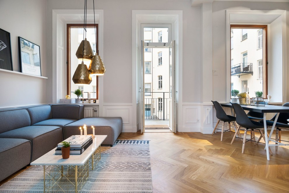 Large danish formal and open concept medium tone wood floor living room photo in Stockholm with gray walls, no fireplace and no tv