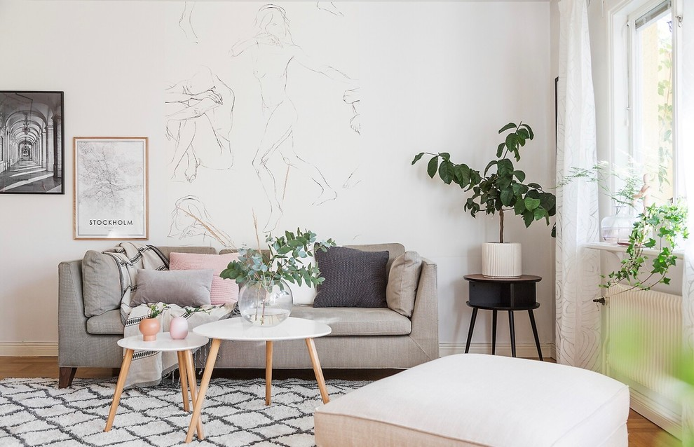 Inspiration for a scandinavian open concept medium tone wood floor living room remodel in Stockholm with white walls