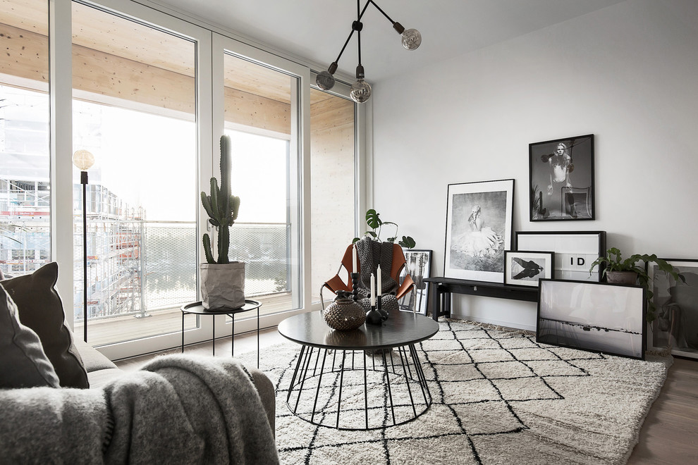 Mid-sized danish light wood floor living room photo in Stockholm with white walls, no tv and no fireplace