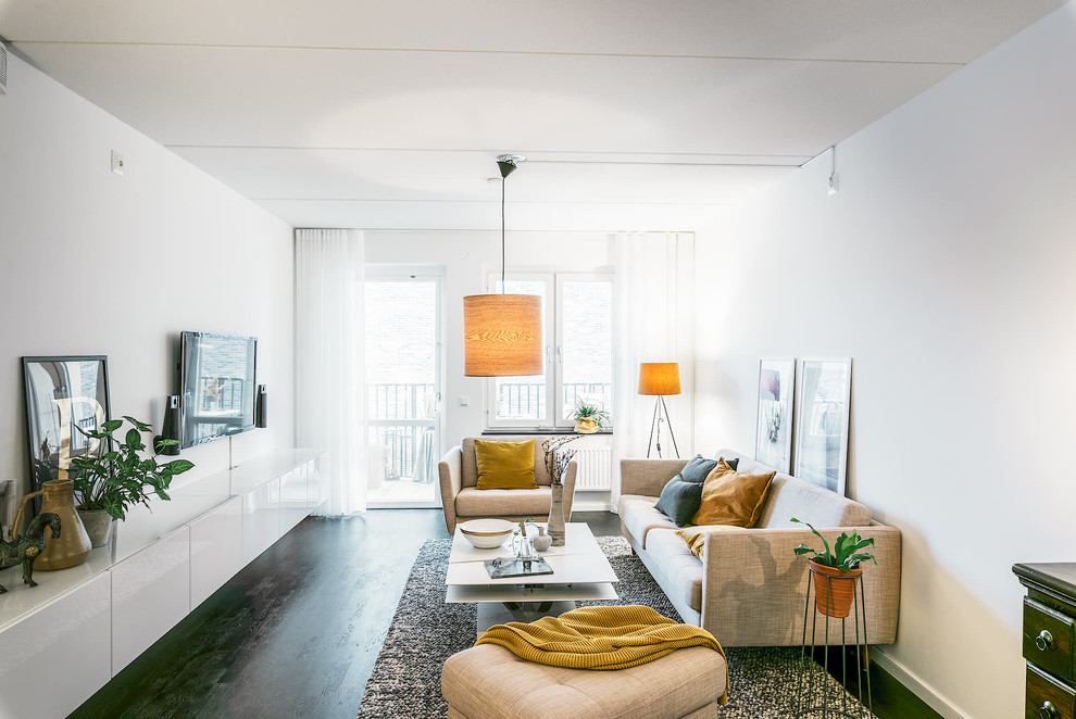 Inspiration for a mid-sized scandinavian enclosed painted wood floor and black floor living room remodel in Stockholm with white walls and no fireplace