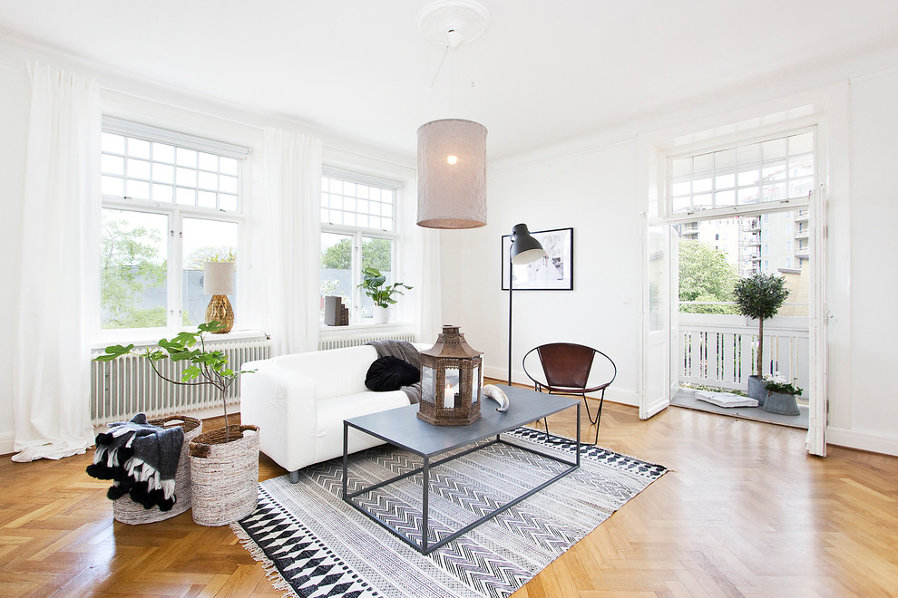 Inspiration for a mid-sized scandinavian formal and open concept light wood floor living room remodel in Malmo with white walls, no fireplace and no tv