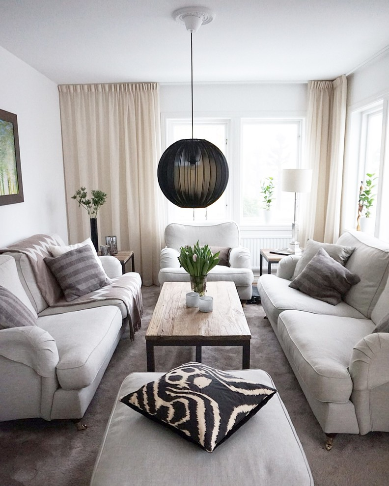 Inspiration for a large scandinavian open concept carpeted living room remodel in Gothenburg with white walls, no fireplace and no tv