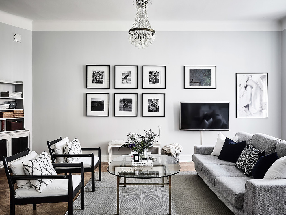 Large danish formal and open concept medium tone wood floor living room photo in Gothenburg with gray walls, no fireplace and no tv