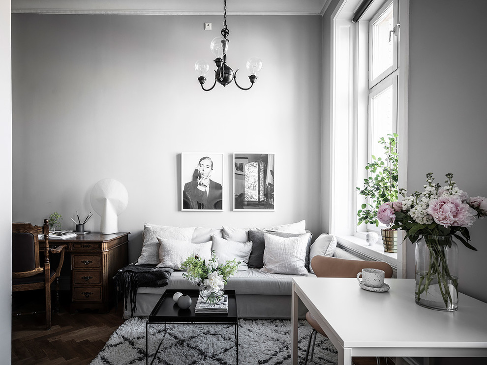 Inspiration for a scandinavian dark wood floor and brown floor living room remodel in Gothenburg with gray walls