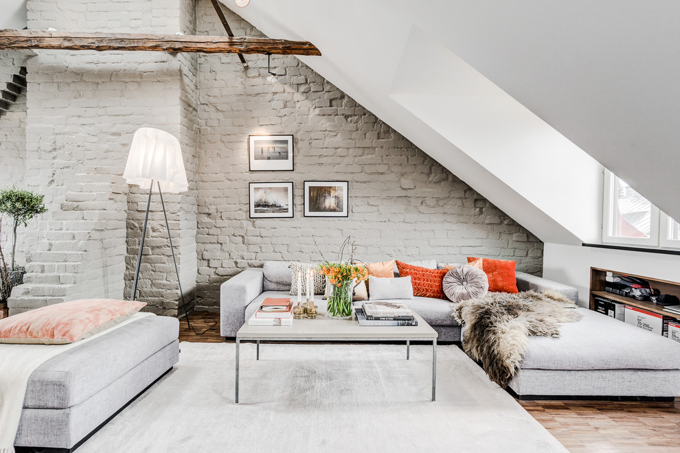 Inspiration for a large scandinavian open concept medium tone wood floor and brown floor living room remodel in Stockholm with white walls, no fireplace and no tv