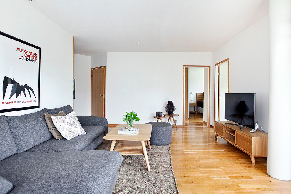 Large danish formal and open concept light wood floor living room photo in Malmo with white walls, a tv stand and no fireplace