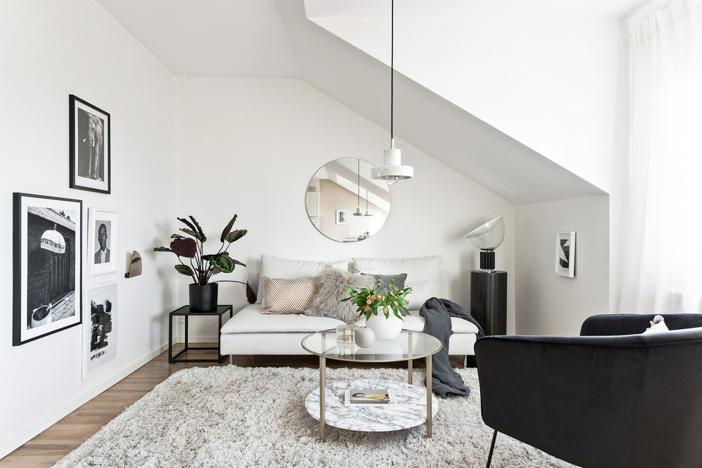 Small danish formal and loft-style light wood floor and beige floor living room photo in Gothenburg with white walls