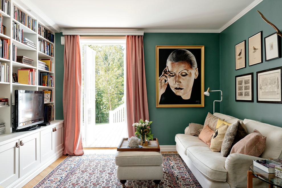 Example of a mid-sized danish formal and enclosed light wood floor living room design in Stockholm with green walls and a tv stand