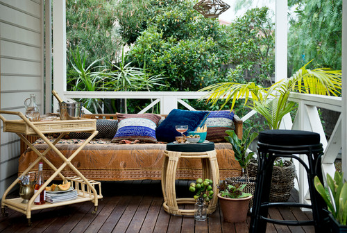 Use a Bar Cart on a covered porch! See all 15 CREATIVE ways to use and style a bar cart in your home.