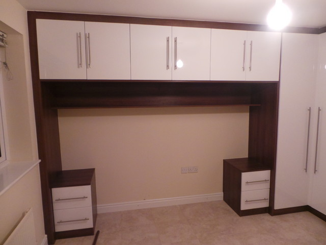 beautiful over the bed unit with matching wardrobe and