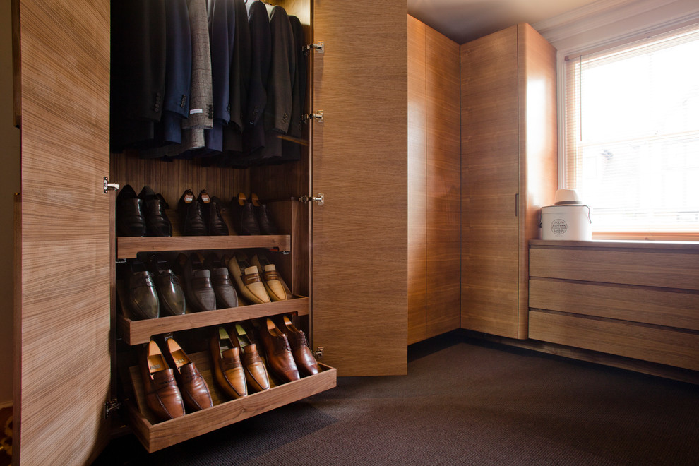 Example of a trendy closet design in Other