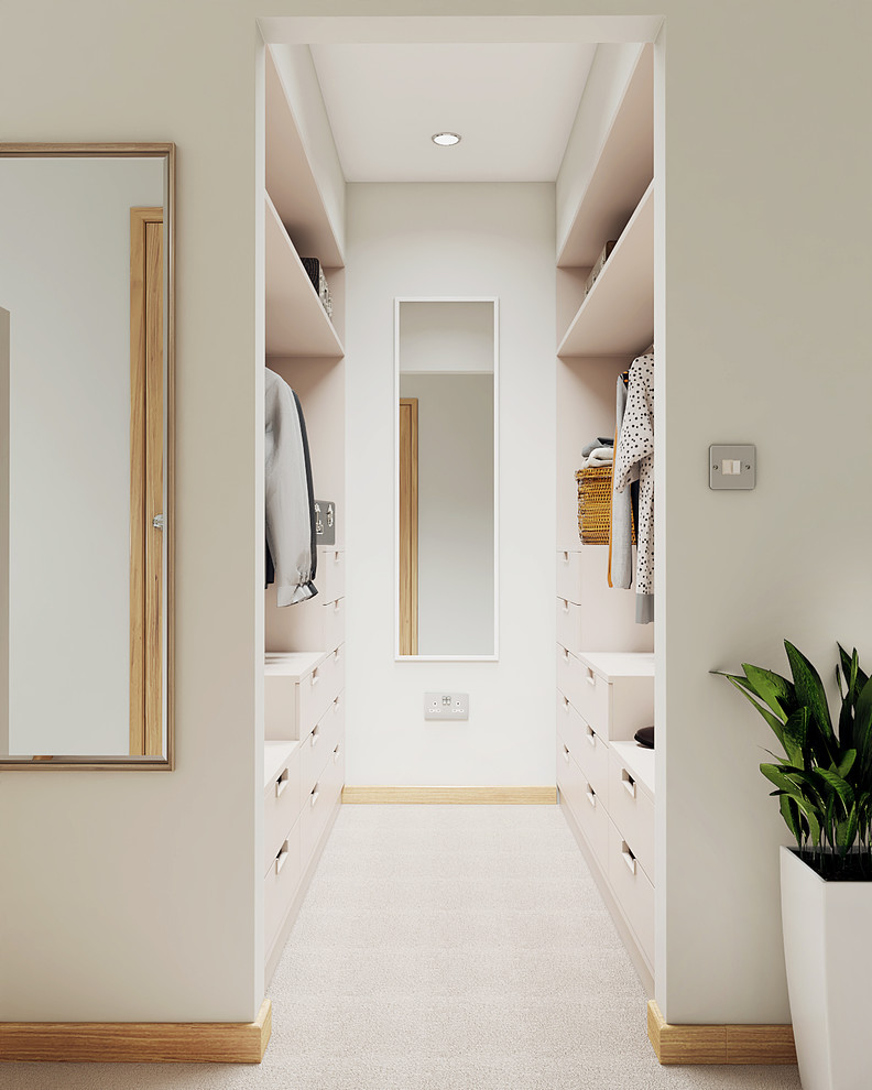 Small trendy gender-neutral carpeted dressing room photo in Cambridgeshire with flat-panel cabinets and white cabinets