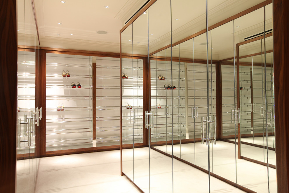Inspiration for a large contemporary gender-neutral dressing room remodel in London with flat-panel cabinets