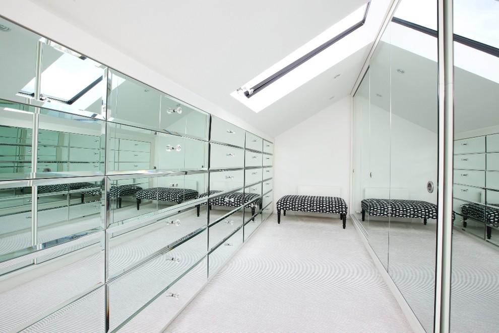 Walk-in closet - contemporary carpeted walk-in closet idea in London