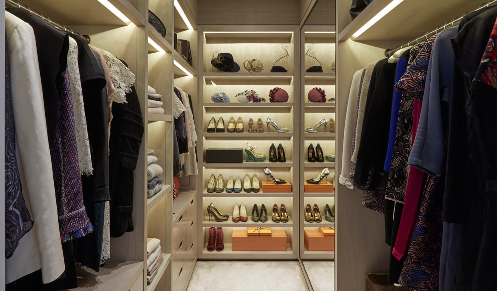 Inspiration for a contemporary women's walk-in closet remodel in London with open cabinets and light wood cabinets