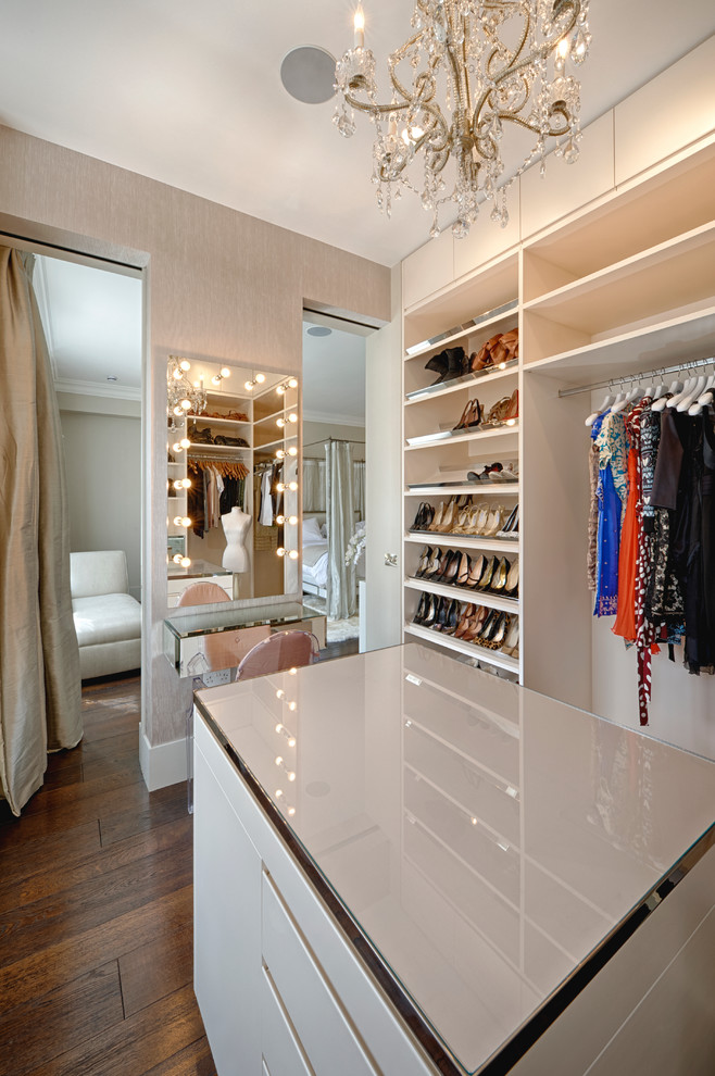 Inspiration for a contemporary dark wood floor dressing room remodel in Surrey with white cabinets