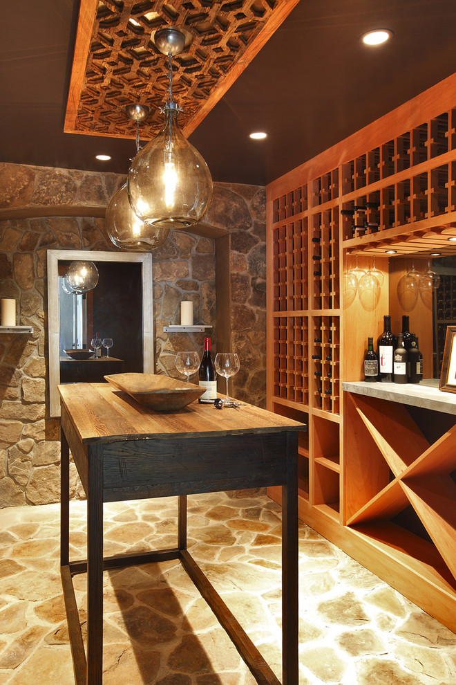 Inspiration for a mediterranean yellow floor wine cellar remodel in New York with storage racks