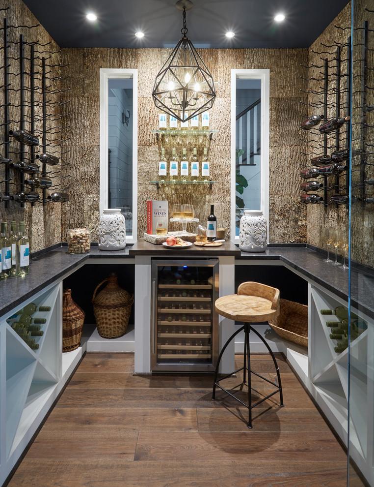 Wine cellar - mid-sized traditional dark wood floor and brown floor wine cellar idea in Houston with diamond bins