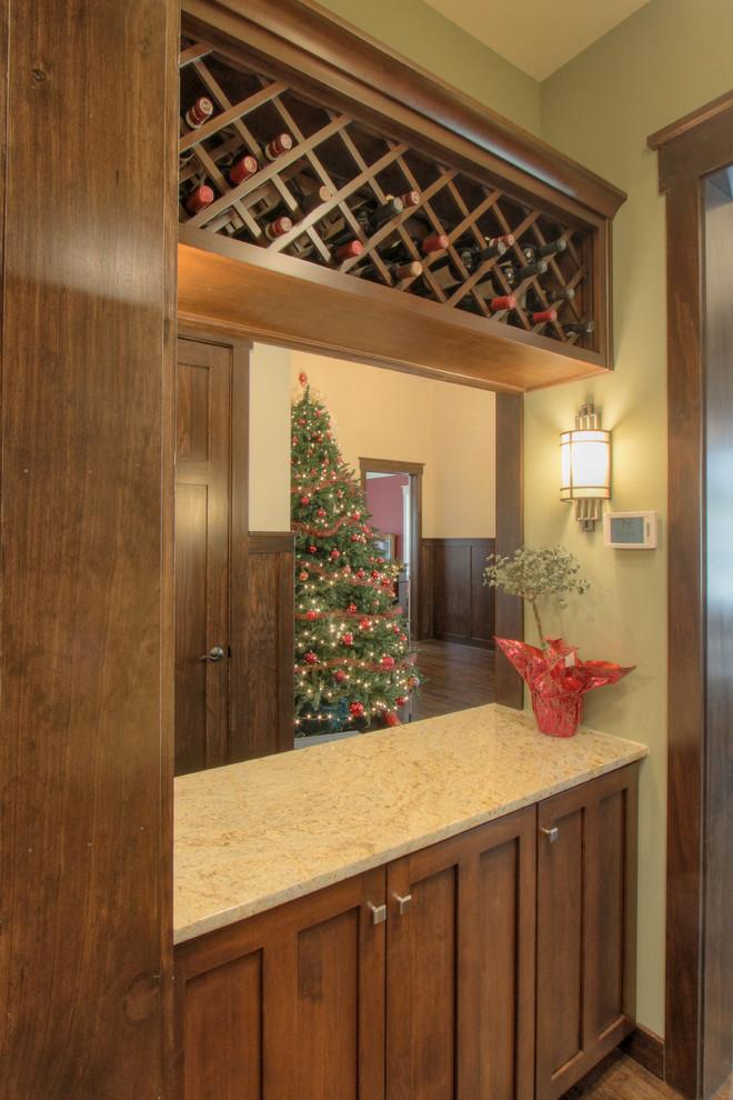 Example of an arts and crafts dark wood floor wine cellar design in Atlanta
