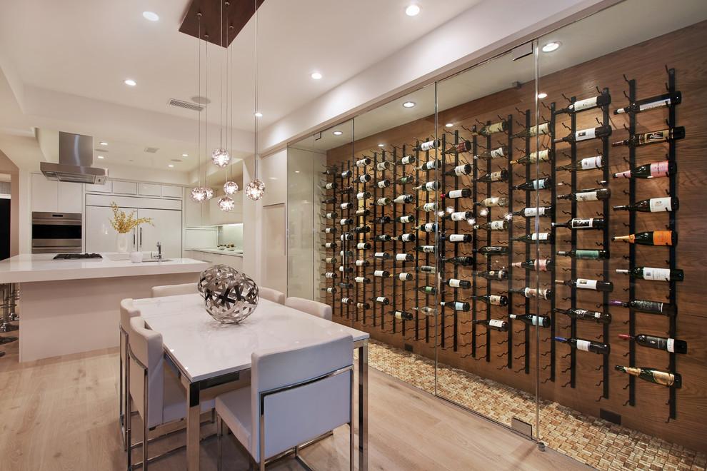Trendy yellow floor wine cellar photo in Orange County with display racks